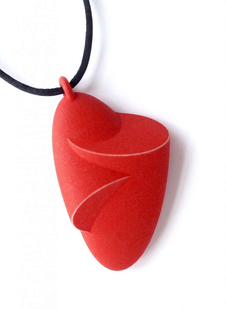 Celebrating Anarkik Creators - Birgit Laken: 'Hug' Pendant in 3D printed and hand-dyed polyamide.