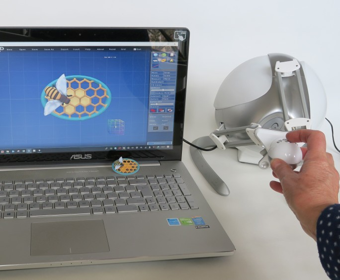 Anarkik3DDesign haptic 3D modelling package: laptop with digital design of a 'bee' pin, Falcon haptic device and 3D printed 'bee' pin.